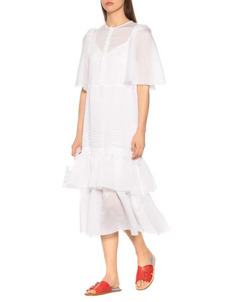 艾克妮女装品牌2019春夏新款文艺休闲不规则白色短袖荷叶边连衣裙