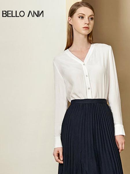 贝洛安女装品牌2019秋季新款上衣设计感小众V领单排扣白色长袖衬衫