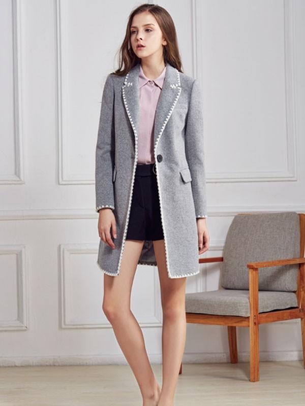 都市衣柜女装品牌2020春夏新款纯色纽扣长款外套